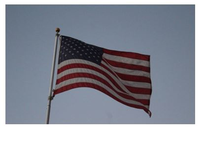 """The American Flag waving in the wind"""